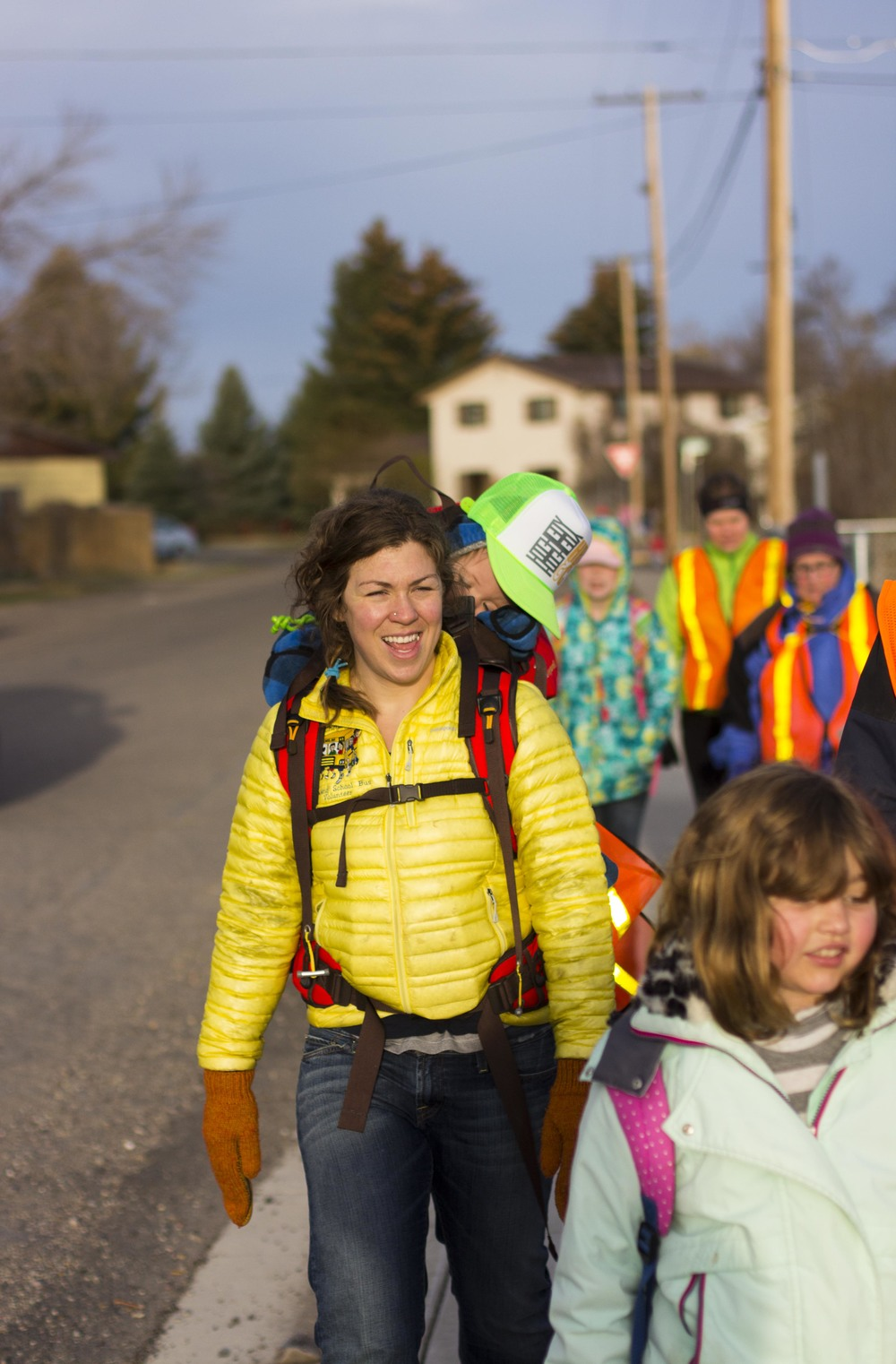 Dillon Walking School Bus Coordinator Cheyanne Sparks walking to school with WSB Route #1 paricipants.
