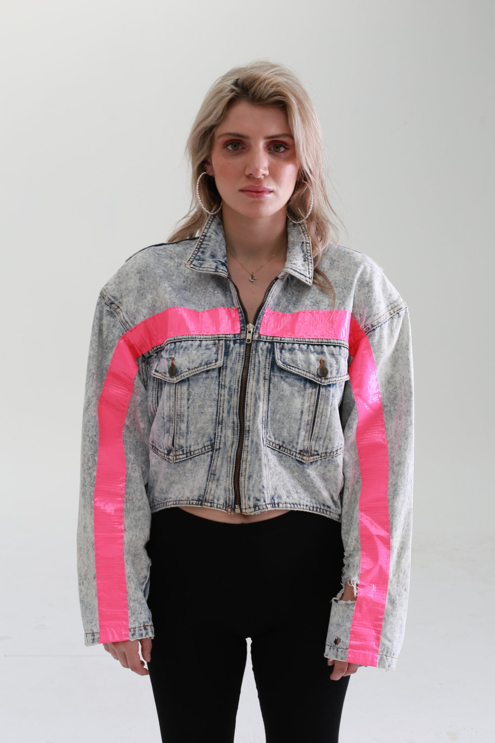 A one off bleached vintage denim cropped jacket, with relaxed shoulder and a silver zip at the front - don't forget the big utility pockets at the front. We have upspeced this jacket by adding neon pink stripes at the front and back -only one made of these.