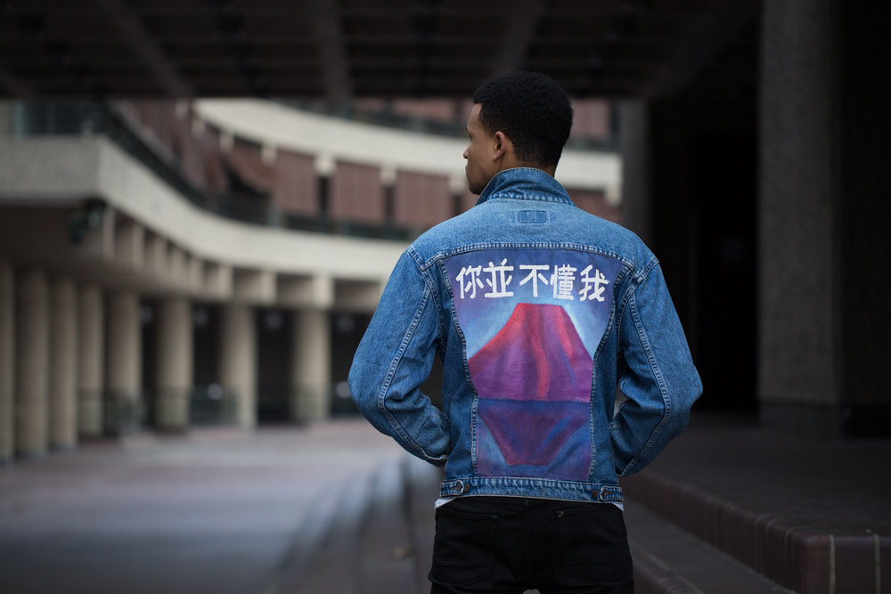Our vintage Levi's trucker in mid wash navy with the famous Mount Fuji hand painted in pinks, purples and blue's. This was inspired by a trip to Japan and seeing the beautiful Mount Fuji. In Japanese text we have painted You don't understand me'. We can create this same jacket but with text of your choice.