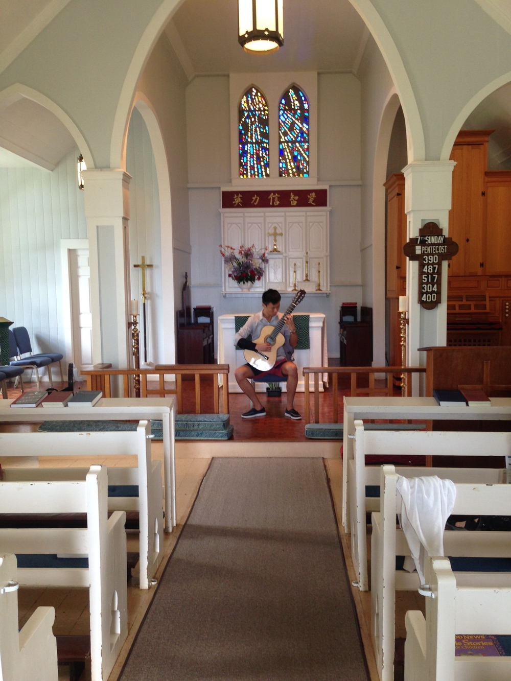 Ray Zhou warming up at St. John's Church, Kula (2014)