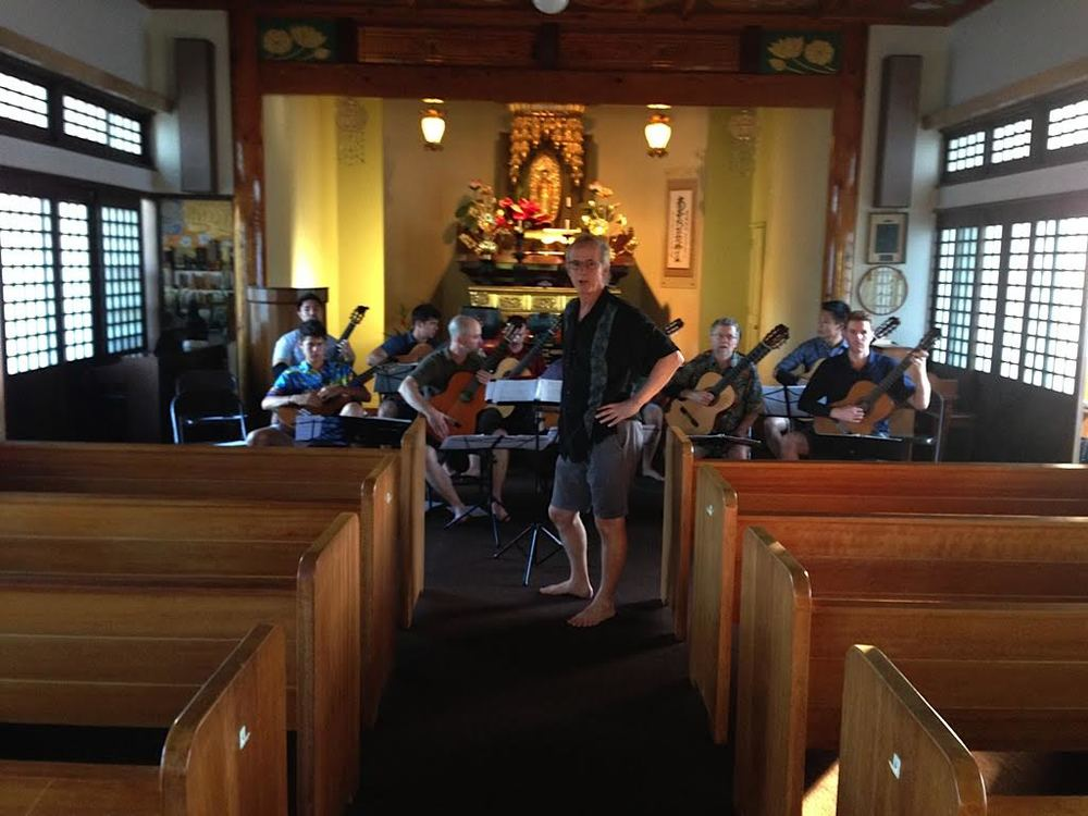 John Dearman rehearsing the guitar orchestra at Lahaina Jodo Mission (2014)