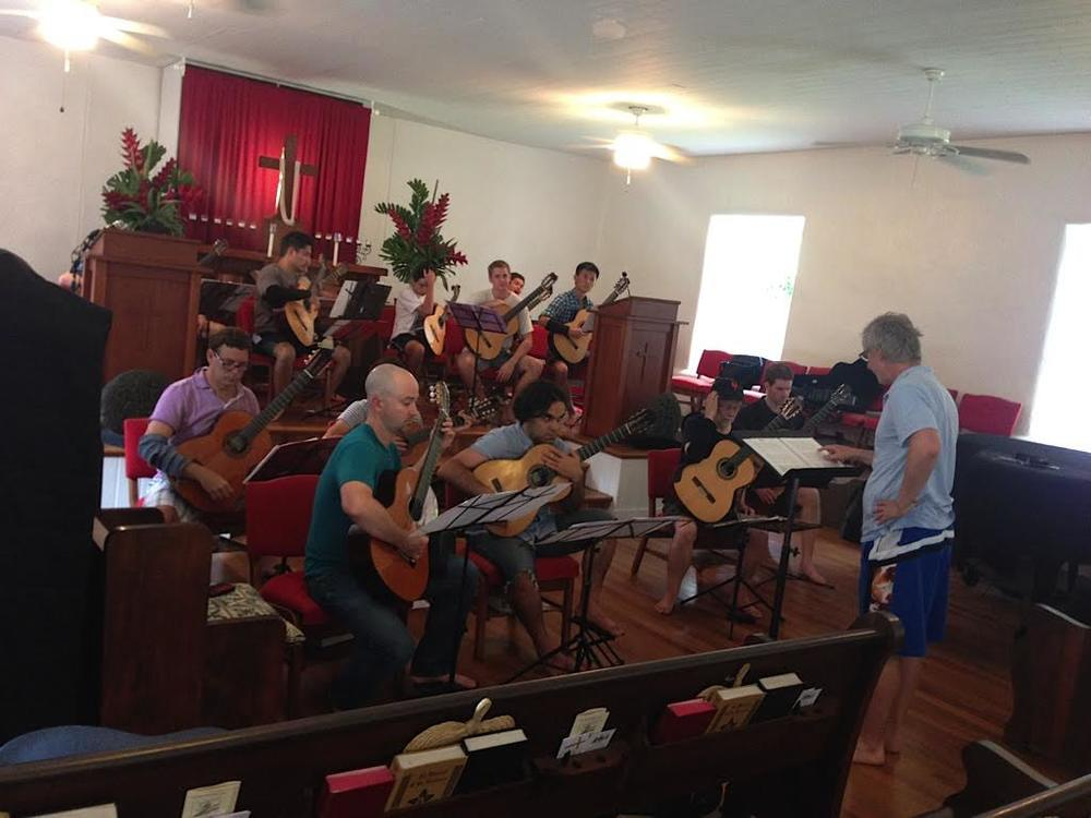 John Dearman rehearsing the guitar orchestra at Keawala'i Church, Makena (2014)