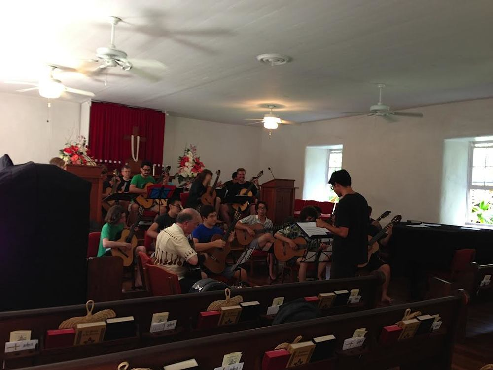 Ian O'Sullivan rehearsing the guitar orchestra at Keawala'i Church, Makena (2013)
