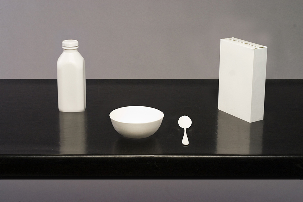 Objects fitting into responsive recesses created in the table's surface.