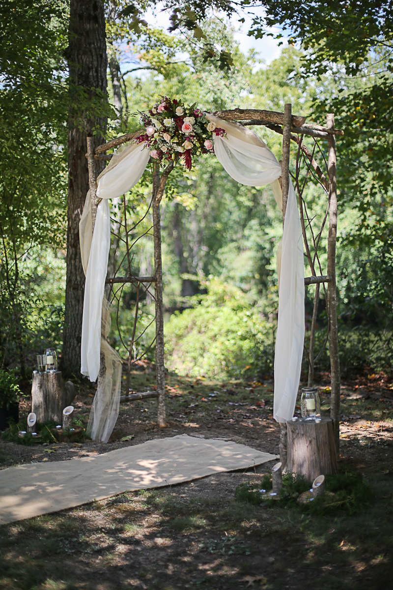 Rustic Wedding Decor, Wooden Altar with Floral Arrangement | Brittany + Michael's Camp Themed Wedding | Virginia Wedding Photographers