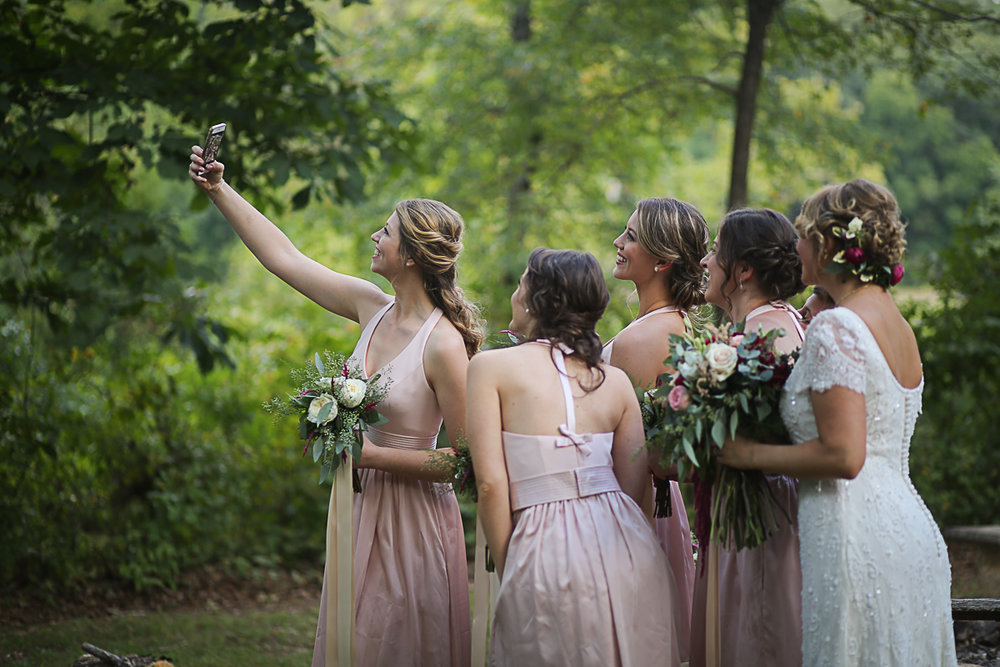 Bride and Bridesmaids Taking a Selfie, Brittany + Michael's Camp Themed Wedding | Virginia Wedding Photographers