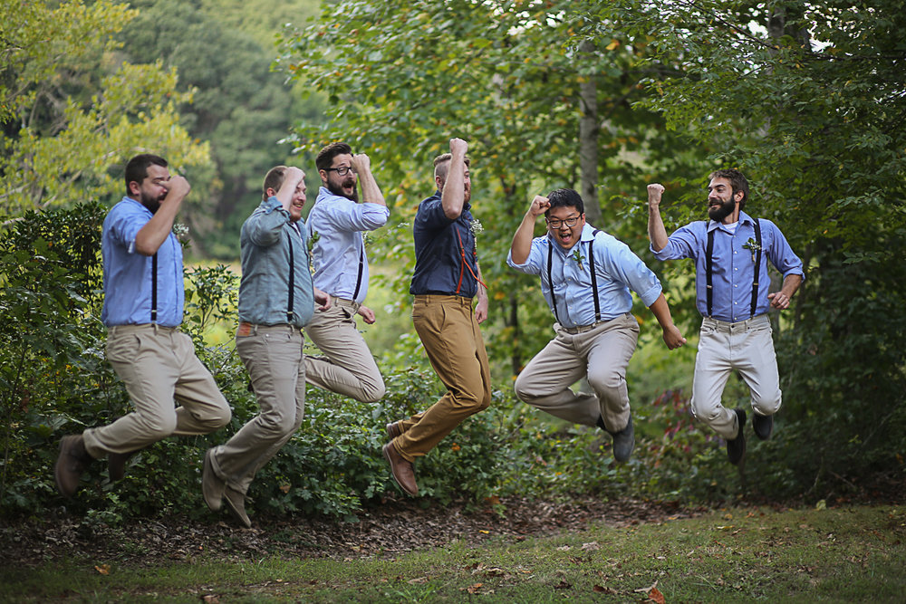 Groom and Groomsmen Jumping Brittany + Michael's Camp Themed Wedding | Virginia Wedding Photographers