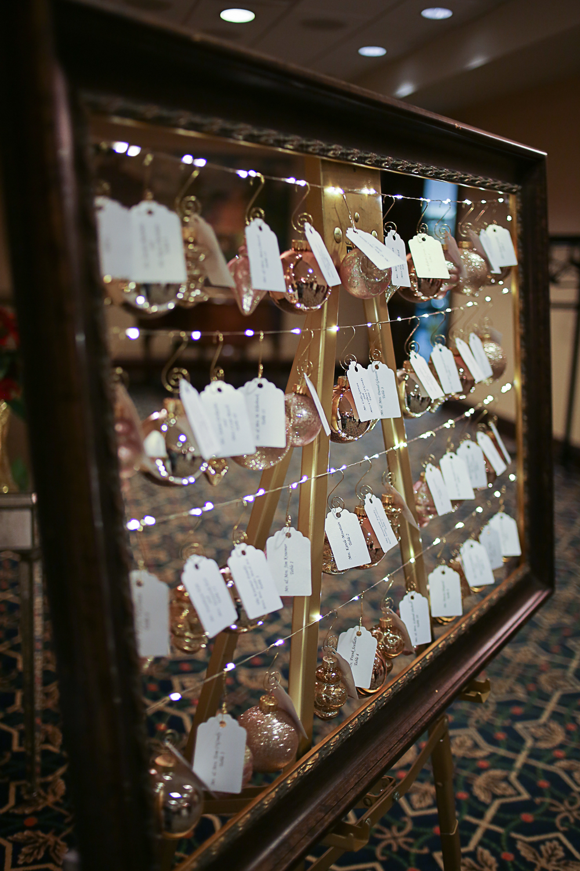 Pink Christmas Ornament Escort Cards, Wedding Seating Chart - Christmas Themed Wedding at Hotel Roanoke | Roanoke, Virginia Wedding Photographer