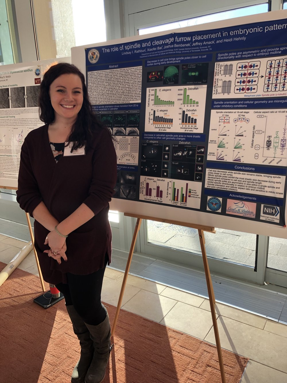 Lindsay at her poster in the SU life sciences complex atrium.