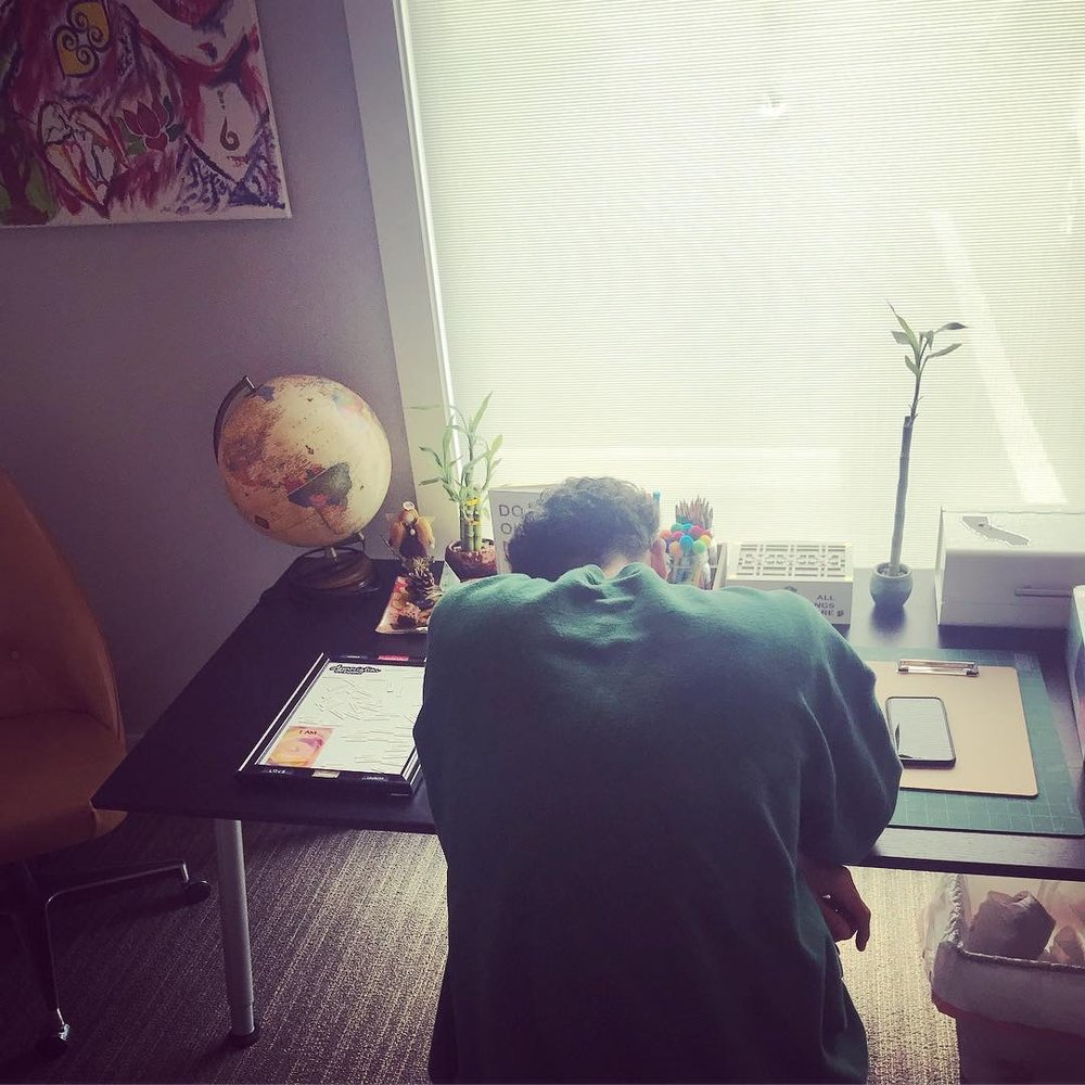 Earth-themed room that inspires creativity and connection to self. Tré Carlisle is pictured here writing an encouraging letter to himself that will be mailed from the center at a 'random' time;)