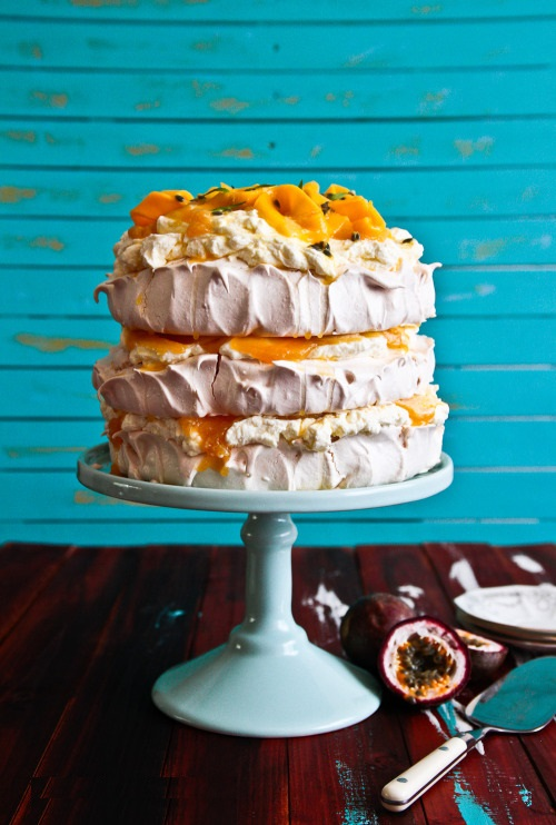 Charity - bright, cheery, fabulous Layered Pavlova Filled with French Vanilla Butter Cream and Passion Fruit Puree (source)