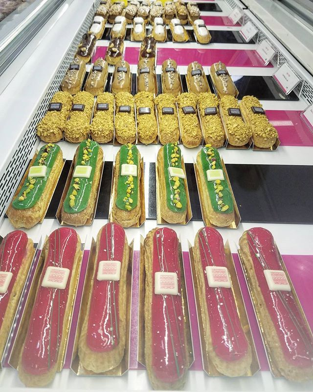 Eclairs for miles! . Raspberry almond, white chocolate pistachio, salted caramel, coffee, chocolate hazelnut, vanilla, passionfruit, chocolate ... they go on and on!! . @sarona
