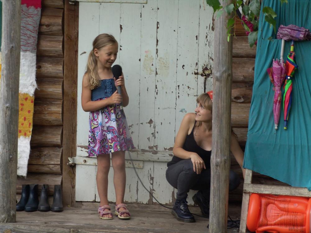 Director Aldona Watts with MarytėKlimavicienė's granddaughter,Rugilė.