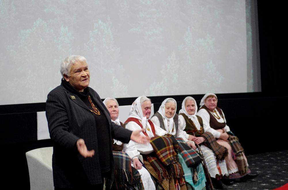 Renowned singer and music historian Veronika Povilionienėand the grandmothers perform before the screening.