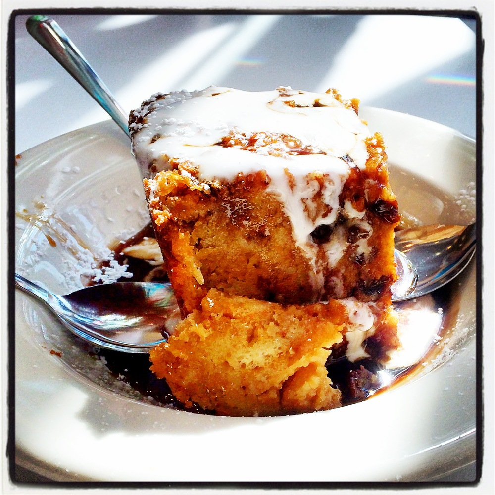ROOT BEER BREAD PUDDING -   Our signature Dessert made with Round Barn Root Beer, Raisins and White Chocolate Sauce