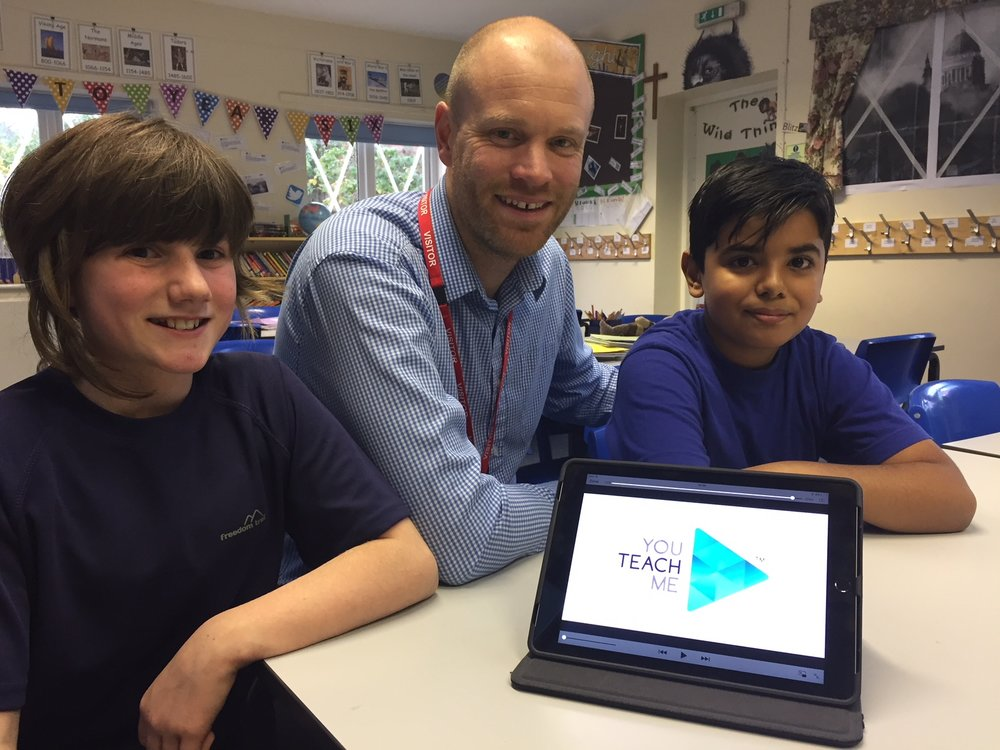 Former Derby headteacher Paul Rose is pictured with Rachel Cartwright (11) and Zeeshan Nazam (10). Paul aims to revolutionise education using an online platform. Penguin PR: public relations, media and communications