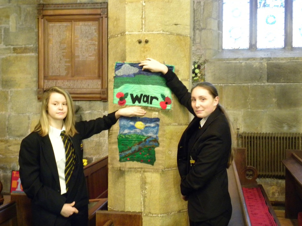 Swinton Academy students Freya Bull and Jess Banks with one of the tapestries presented to St Nicholas' Church as part of their Poppy Memorial Trail to mark 100 years since the end of the First World War. Penguin PR: Public relations, media and communications