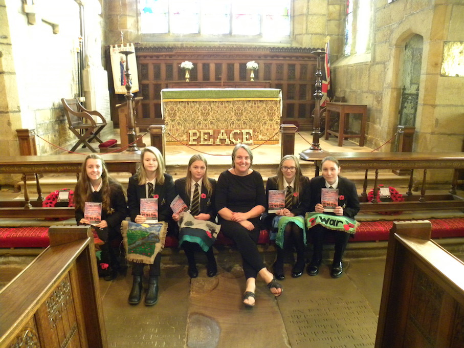From left: Emily Busby, Freya Bull, Kayley Grindrod, Mrs Sally Laughton, Katie Martin & Jess Banks with the tapestries presented to St Nicholas' Church as part of their Poppy Memorial Trail to mark 100 years since the end of the First World War. Penguin PR: Public relations, media and communications