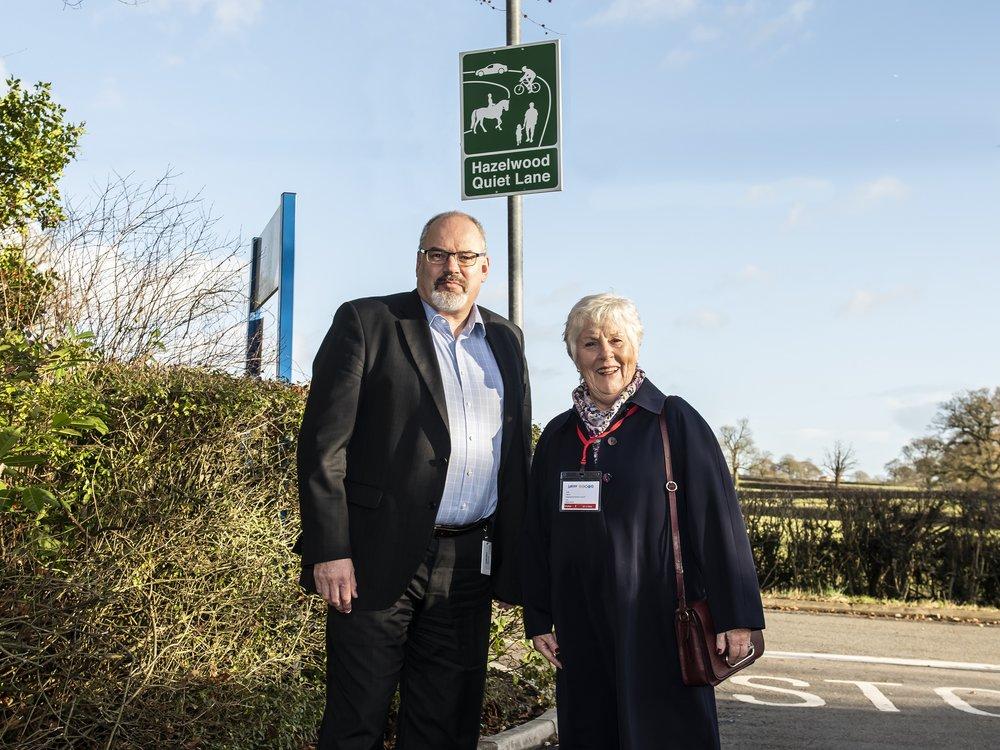 Left, Simon Griffiths, general manager of Lubrizol Hazelwood, and Judy Harris from Hazelwood Parish Council, with the Quiet Lane signs, which have been erected at the entrance to the firm's site in Nether Lane. Penguin PR: public relations, media and communications