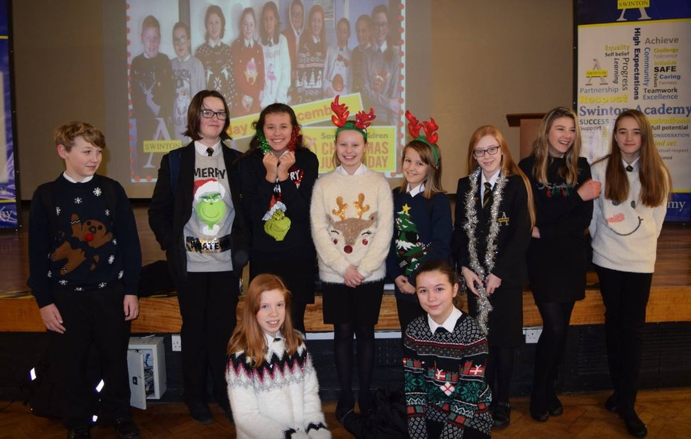 Year 7 pupils from Swinton Academy show off their Christmas jumpers. Max Godber Millie Ramsden Grace Cawkwell Lucy Hurst Latia Redman Y8 Emma Taylor Mia Brown Lilannah Young Front - Kadie Davis, Teegan Latham. Penguin PR: public relations, media and communications.