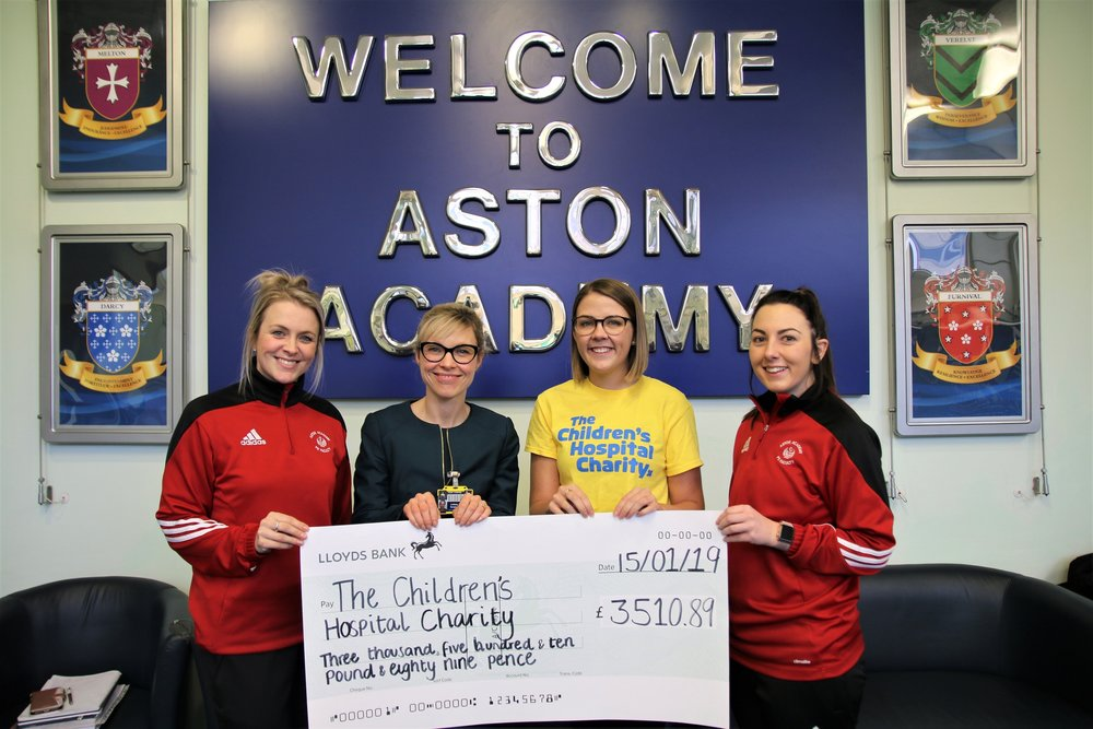 From left, Louisa Longstaff, PE and health and social care course teacher at Aston Academy, assistant Academy principal Lindsey Burgin, Freya Kingswood, community fundraising assistant at The Children's Hospital Charity and Sam Rendi, PE and health and social care course teacher, with a cheque for £3,510, which the school raised for the charity's Snowflake Appeal. Penguin PR: public relations, media and communications
