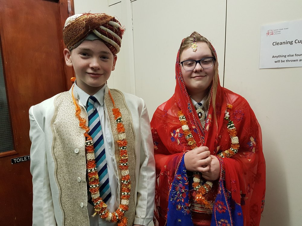Shirebrook Academy Year Seven students Ben Brooks and Chloe Evans try some Hindu wedding garments on for size. Penguin PR: public relations, media and communications.