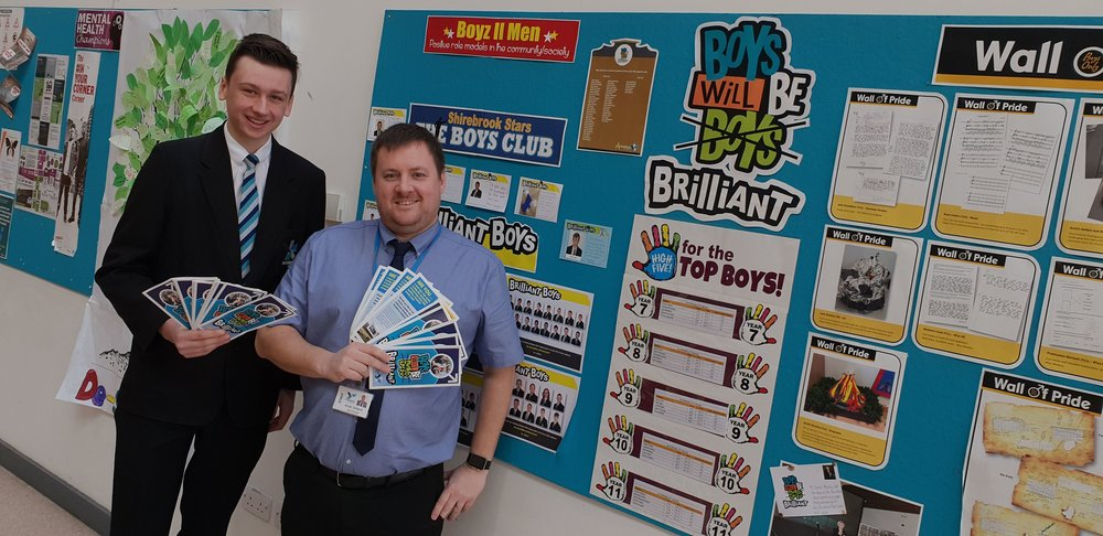 Shirebrook Academy student Ben Clarke and vice principal Andy Gilbert with the school's boys-only wall of fame, which has been installed to help male students raise their aspirations and see achieving at school as desirable. Penguin PR: Public relations, media and communications