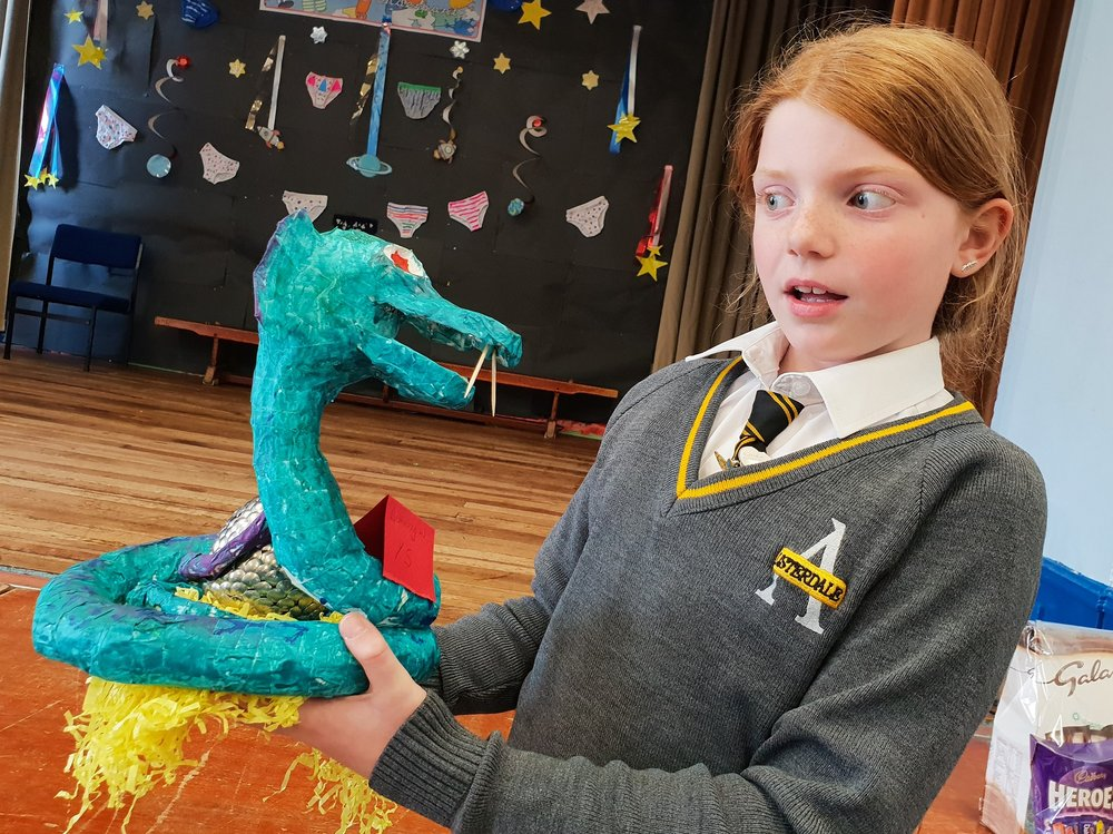 Bethany Winterbottom, 10, comes eye-to-eye with her creation - a scary snake guarding an Easter egg. Penguin PR: public relations, media and communications