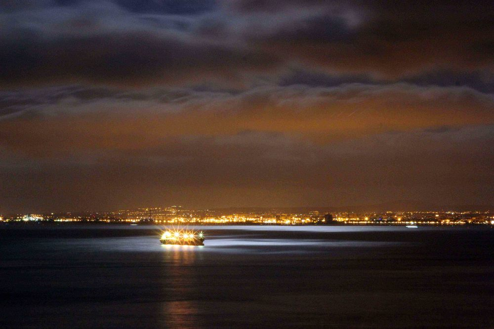 Tagus river by night will make you stop