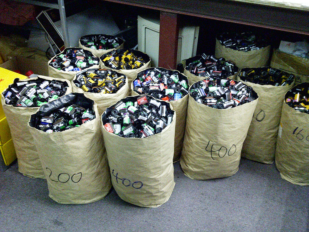 zdp-189: A small fraction of Dot-Well Photo Workshop's 135 cans for recycling. It's still possible to be a successful high street lab.