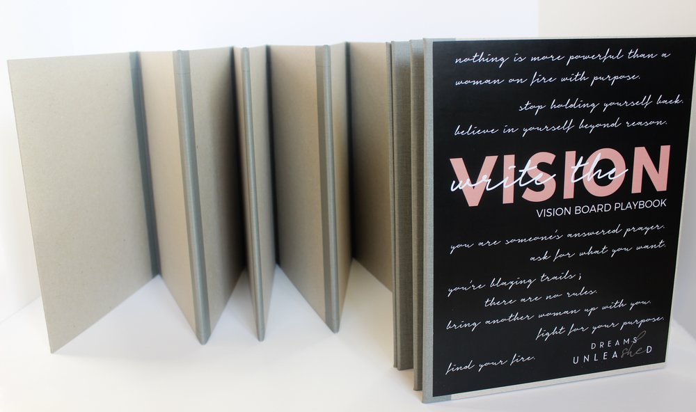 Two Vision Board PlayBooks pictured.   Book on the left is blank as customer would receive it. Book on the right is partially closed and features the cover that accompanies the Vision Board PlayBook.