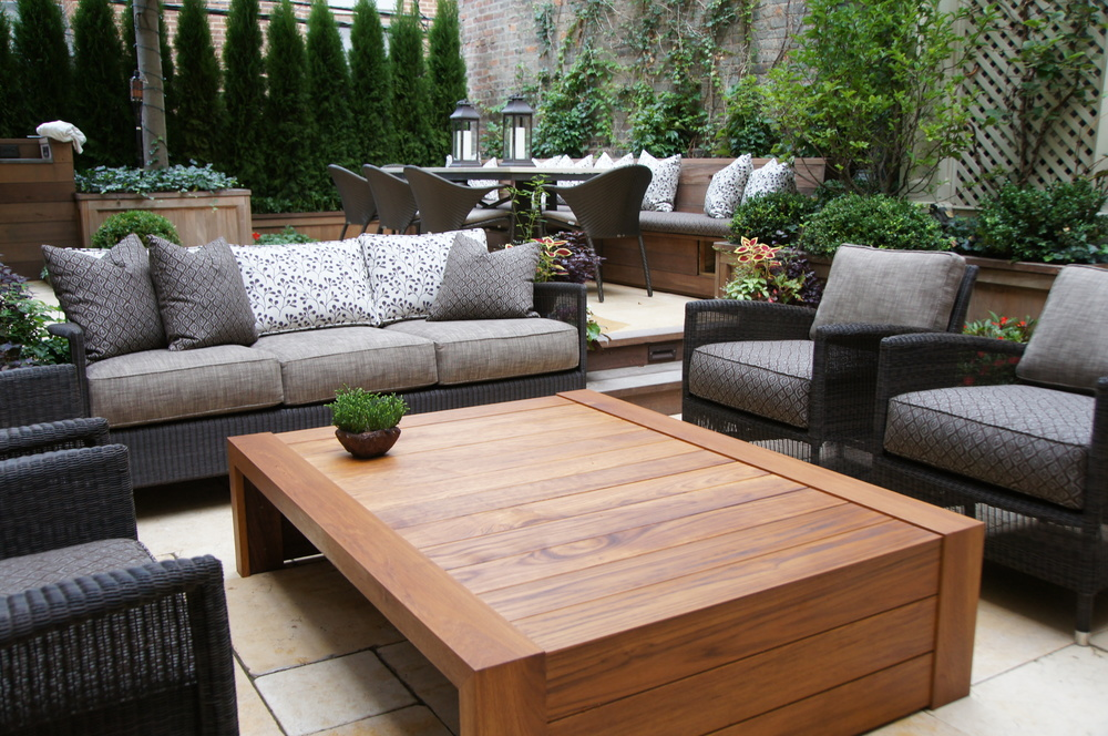 TRU Furniture custom teak outdoor coffee table.  Solid teak plank construction.  TRU is set up to fabricate both outdoor case goods and upholstery using teak and flow through foam fills for seating.