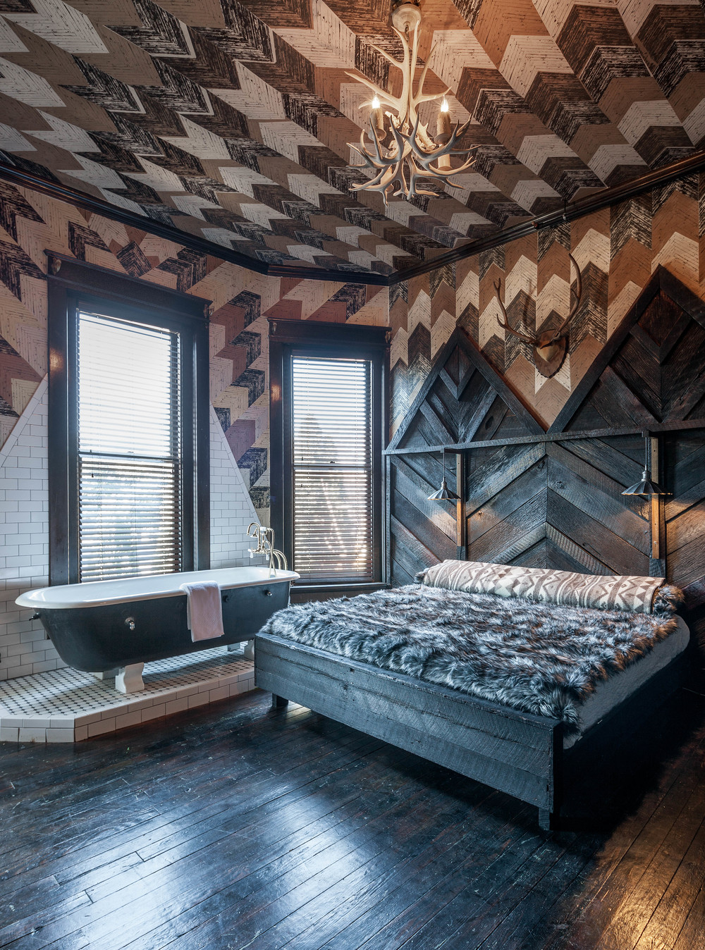 Reclaimed charred Heart Pine bed in 'The Midnight Rider' Bedroom.