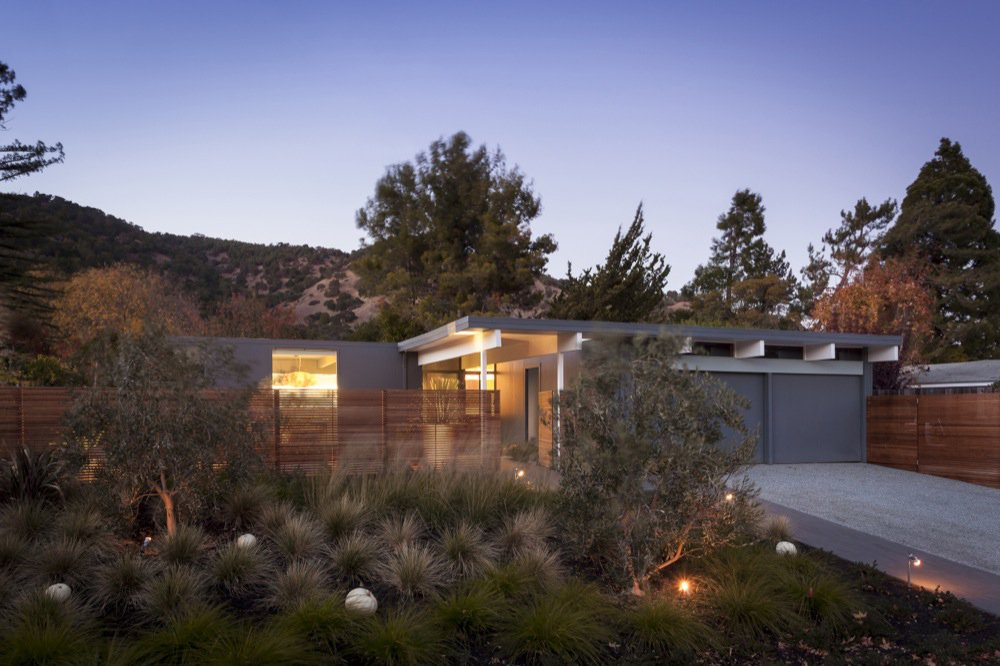 the-exterior-of-a-renovated-eichler-home-at-night.jpg