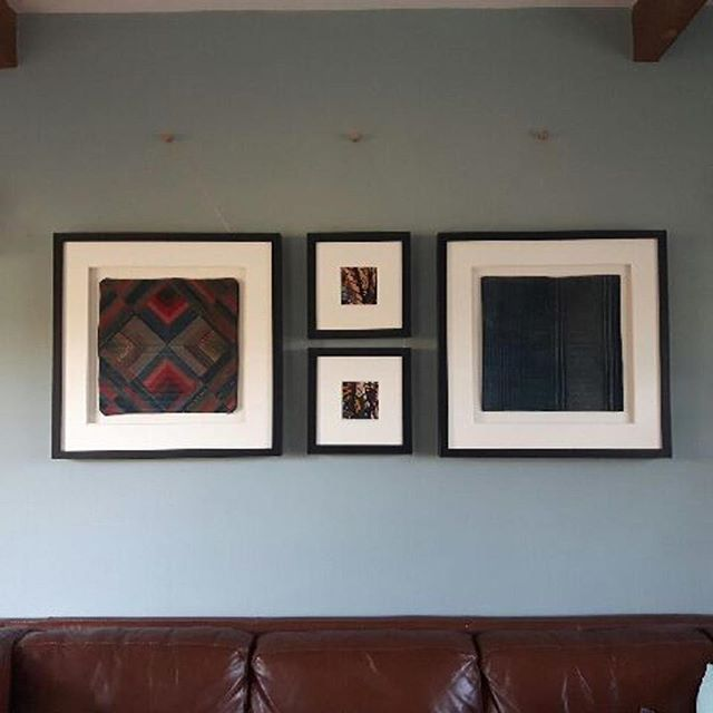 Framed cushions to the left and right and framed batik fabric in between. Extra thick mountboard and non-reflective glass in each. Love the hanging arrangement!