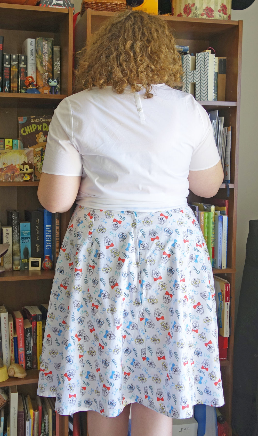 Backside of woman in chip n dale skirt