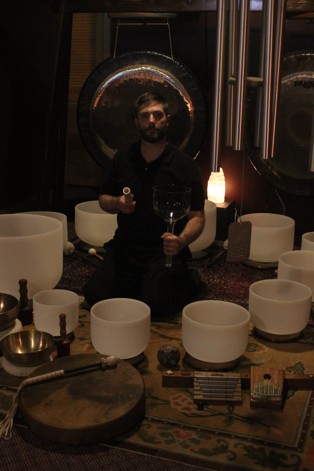 crystal singing bowls , gongs , wind chime , shaman drum , tibetan bowls.