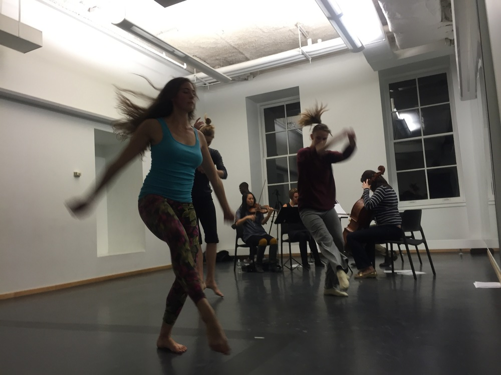 Hair flies in the wind as dancers and musicians  rehearse together for the first time.