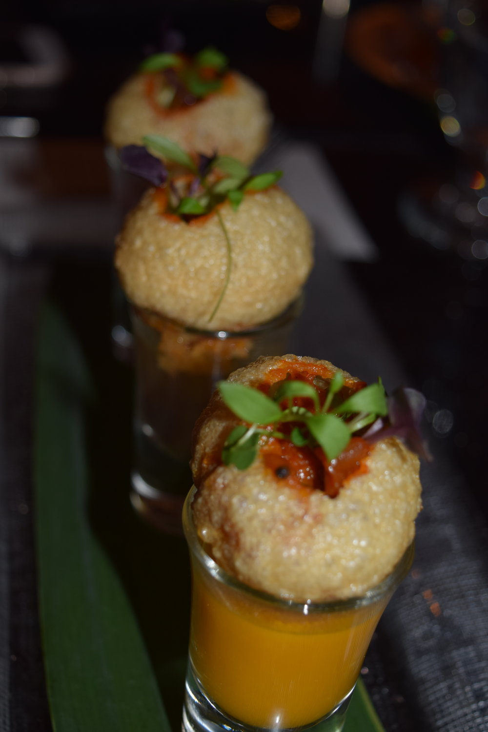 SHRIMP PUCHKA SHOTS (semolina puffs, spiced shrimp, tomatoes, onions, with a trio of chasers - kokum, mango and tamarind-cumin)