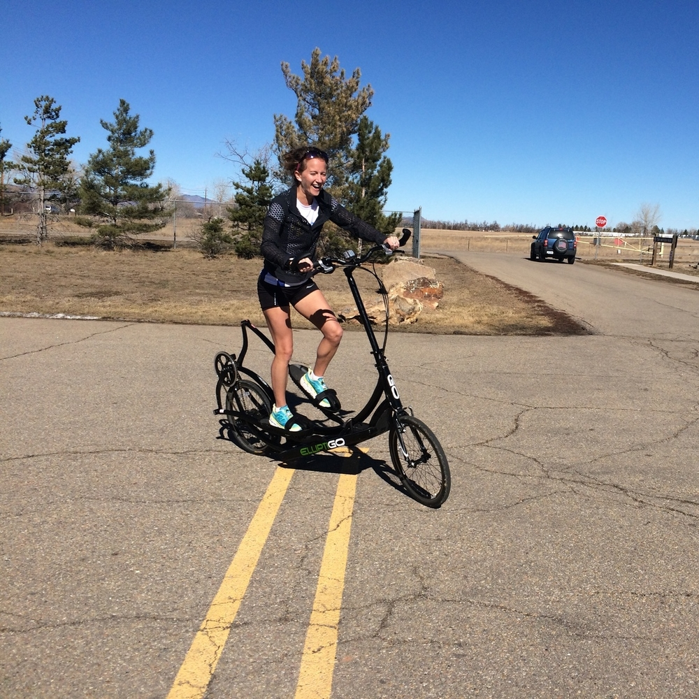 Nicole Camp all smiles while riding the ElliptiGO