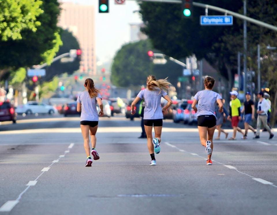Kara, Addie, and Nicole warm up on the streets of LA. Photo cred: Justin Britton