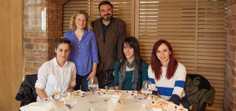 Julie Kiernan, pictured in blue, standing beside the founders of the Balkan Heritage Foundation and Archeon BiH.