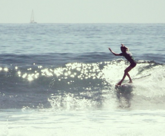 Here's Julie hanging 5 in one of her heats at Malibu. Photo: Rel Lavizzo-Mourey