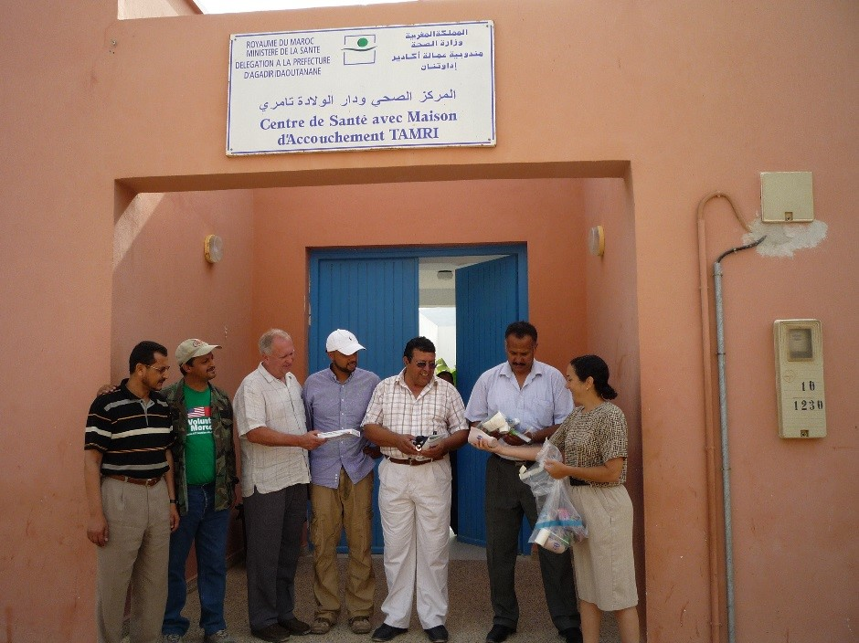IMEC representatives giving gifts to Dr. Bouhsoune after assessment at Tamri dispensary