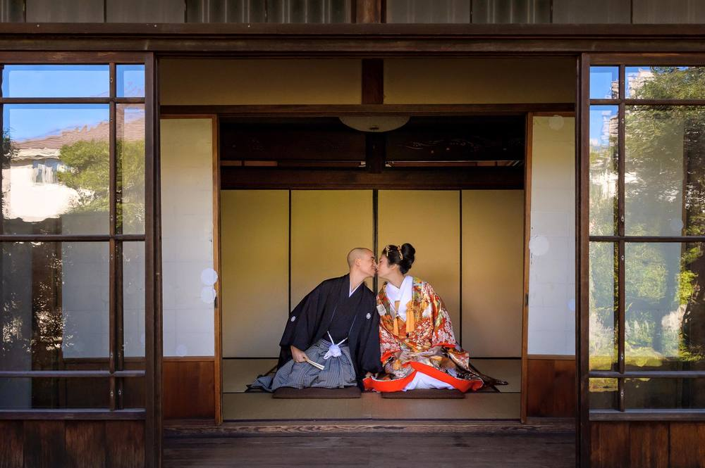 the non traditional couple photo - sitting in seiza position with a kiss (tho it was extremely difficult for me to even lean over! haha!