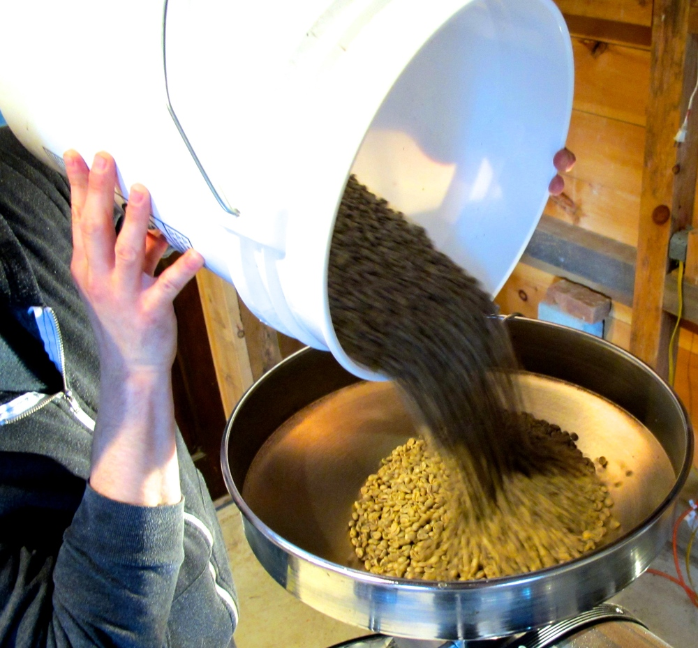 Loading green beans into the roaster.