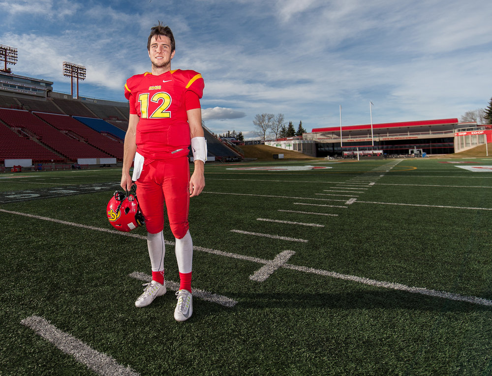 University of Calgary Dinos quarterback Adam Sinagra is off to the Hardy Cup Finals after a dominating performance against the University of Saskatchewan Huskies during football action at McMahon Stadium in Calgary on Saturday, Nov. 5, 2016. The Dinos finished the semifinal game 47-17 with Sinagra throwing three touchdowns and 271 yards. (Photo by Maxwell Mawji/ www.CaptureCandy.com)