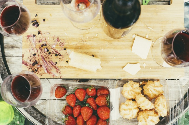 Skip the drinks and invite friends over for cheap wine to save money for your dream vacation