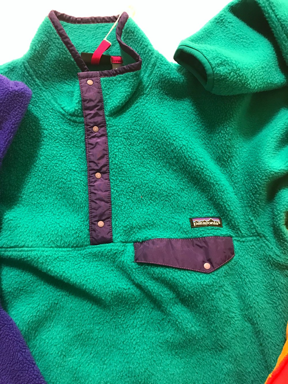"This early Synchilla Snap-T has been added to the permanent collection at MoMA. Of special note, the off-set snap on the chest pocket was designed by a member of Patagonia's sailing department. ""It kept his sunglasses from sliding into his armpit,"" Laine explained. That shape continues to reappear in designs new and old today."