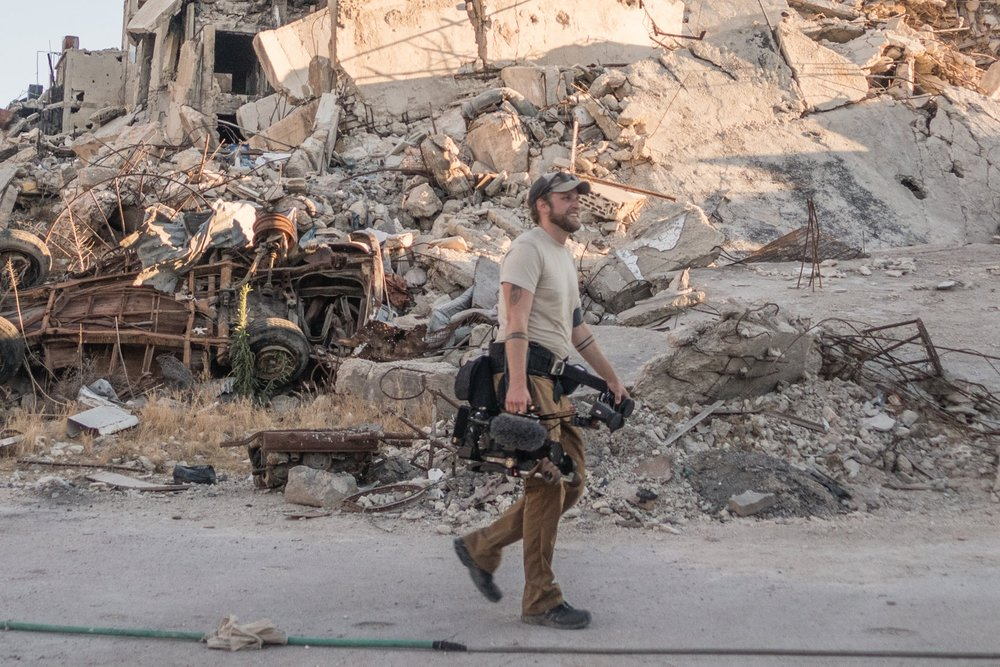 Chumbley filming in Homs, Syria. 2016.